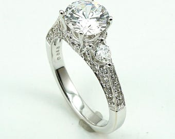 Engagement Ring 18K WG CZ Center Stone with 42-Diam Side Stones at 0.95 Cts.