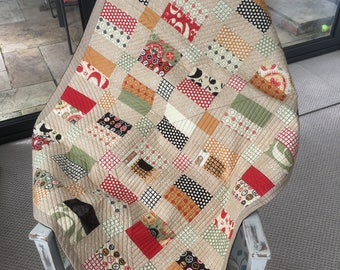 Geometric Black and Tan Lap quilt