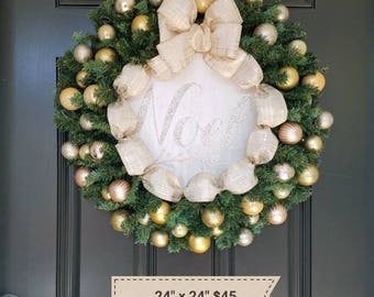 Beautiful Gold Ornament and Evergreen Christmas Wreath with Noel Sign