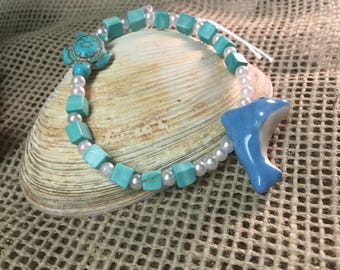 Dolphin and turtle stretch bracelet with howlite cubes