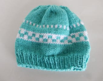 Knitted turquoise baby hat