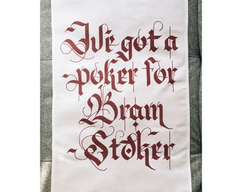Bram Stoker Tea Towel for satanic dishes. Handwritten gothic lettering printed onto a cotton tea towel
