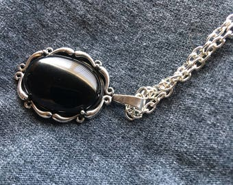 Black onyx and silver scroll pendant