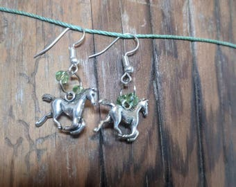 Horse earrings with green accenting beads