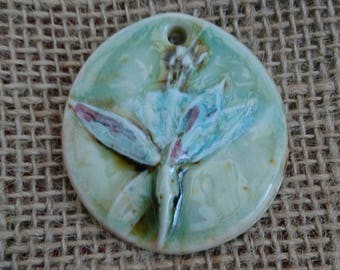 Handmade ceramic rustic and textured  botanical pendant./ gift.