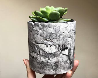 Black and white marbled concrete planter