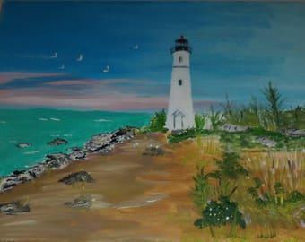 White Lighthouse On Beach