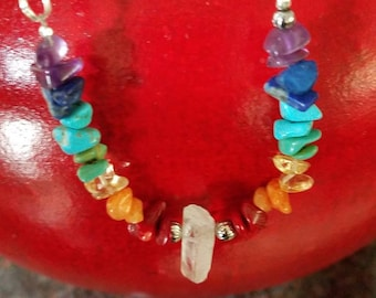 Chakra necklace with semi precious gemstones including amethyst sodalite turquoise citrine and coral and quartz