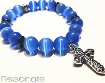 Blue tiger eye bracelet, with cross.