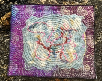 """Table mat, hand dyed, felted, and quilted, 12.5"""" by 15""""."""