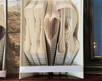 Initial folded book art