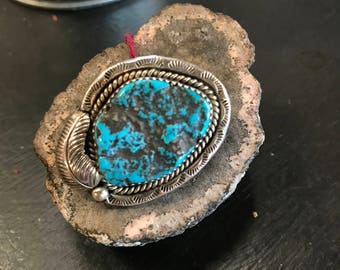 Large turquoise and sterling ring.Handstamped, feather detail.
