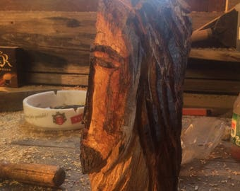 Chainsaw carved face