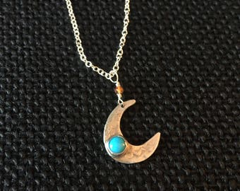 Sterling silver crescent moon necklace with turquoise.