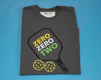 PickleBall Shirt- Zero Zero Two with paddle