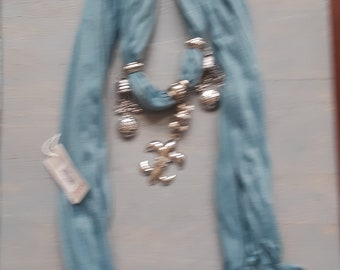 smoke blue scarf with silver accessories
