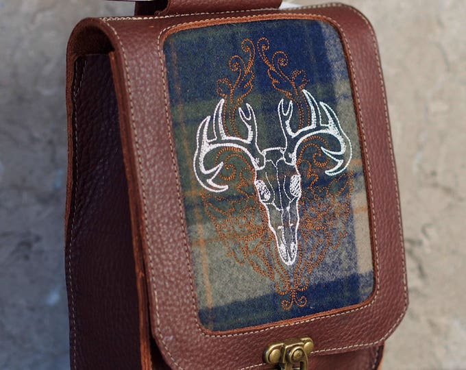 Leather satchel with deer skull embroidered tartan