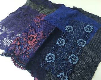 assortment of various smaller sheer lingerie tulle lace / mesh swatches — royal blue / purple — different sizes and patterns