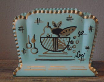 Teal blue tin hand painted napkin holder by Lori, Farber & Shlevin, Brooklyn NY, / gold,black fruit bowl on teal with gold scalopped edge