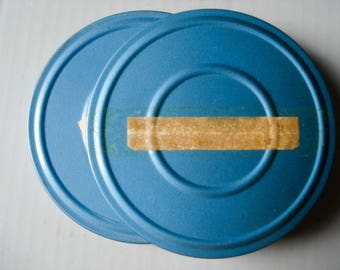 Vintage 8mm film reels and canisters - set of 2 - original film included