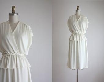 1970s peplum wrap dress