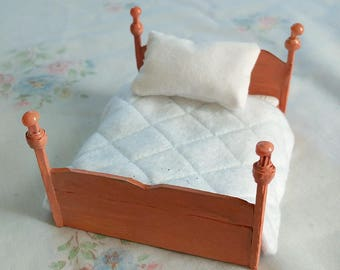 Terracotta wooden dollhouse bed with furnishings, 1:24 scale