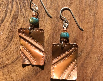 Repurposed roofing copper foldformed and textured earrings.