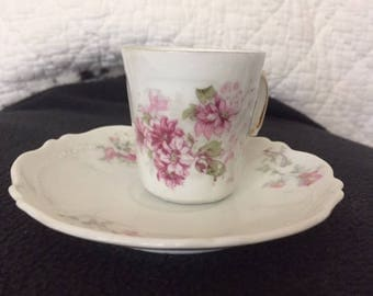 Tea cup with pink flowers
