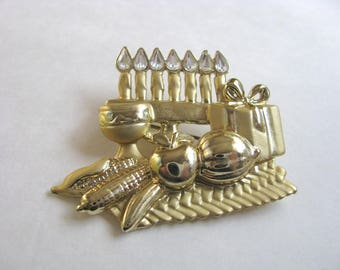 Dimensional Gold tone Holiday brooch pin with gifts, candles by Danecraft
