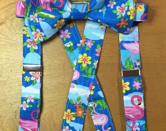 Flamingo suspenders with matching bow tie .