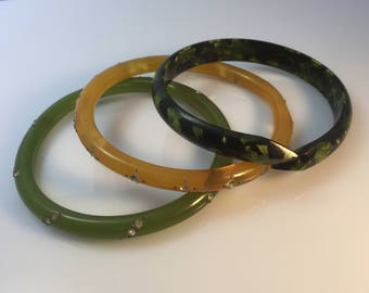 Set of three 1920s art deco celluloid bangles - marbled snake , two tone yellow and apple green with paste stones