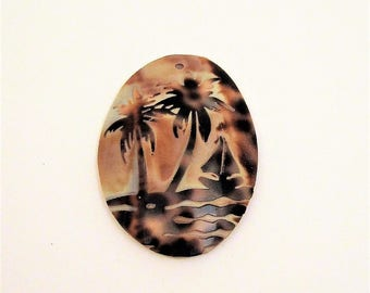 palm tree pendant brown tan oval shell with sailboat