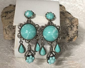 70's Silver tone dangle earrings with turquoise colored stones .
