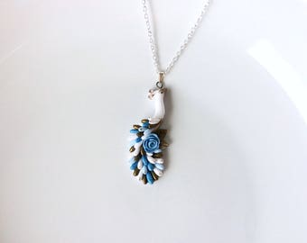 Peacock necklace in white, pale blue and antique gold colours handmade from polymer clay