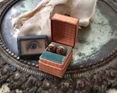 Who Keeps A Pair Of Rusty Tin Doll Eyes In A Plaid Antique Paper Ring Box