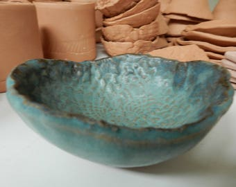 """Free form small round stoneware pottery bowl. turquoise glaze...embossed with lace....5""""x2"""""""