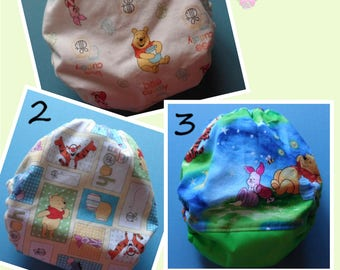 SassyCloth one size pocket diaper with Winnie the Pooh cotton print. Ready to ship.