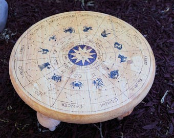 Small wood burned altar featuring the zodiac and constellations