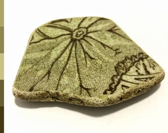 Scottish sea pottery piece, off-white and brown beach pottery with foliage design, washed up on the Edinburgh beach 0467