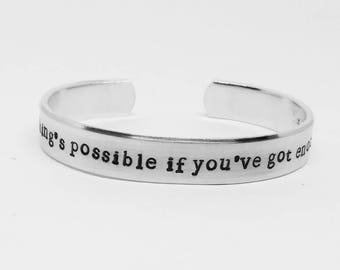 Everything's possible if you've got enough nerve: hand stamped aluminum Harry Potter fandom Ginny Weasley quote cuff bracelet
