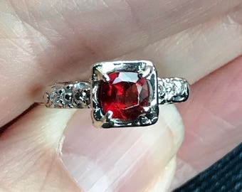 Diamond ring-stunning set with a GARNET 50 points  ......58 points total weight 14KT