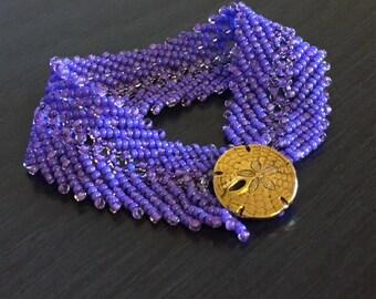 Purple bracelet with sand dollar clasp