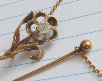 Antique Georgian or Victorian 14k Cushion Mine cut diamond solitaire flower brooch pin with guard