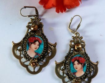 Boho and retro earrings with a portrait on a bronze  filigree