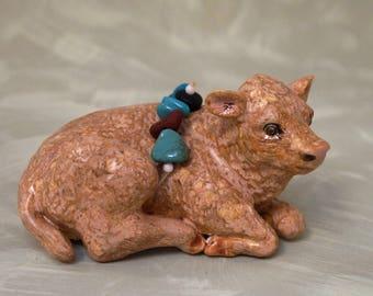 ceramic small laying down buffalo calf totem