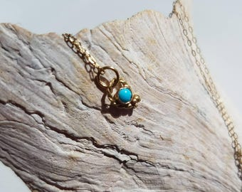 Tiny 14k gold turquoise paisley pendant