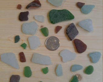 40 Sea glass white, Brown and green maybe some seafoam and pale blue assorted size shapes and qualities