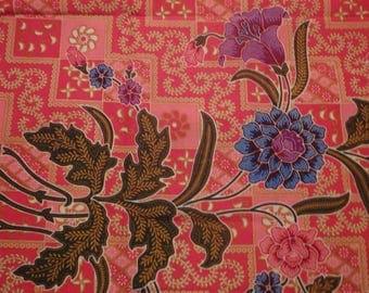 Indonesian pink or  orange colour batik sarong/pareo/fabric. 2 metres in length, stitched.  special Panjang.