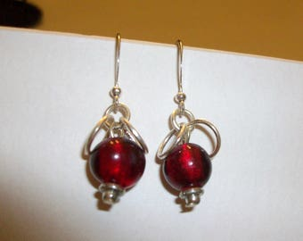 "Red bead earrings.  Dangle earrings about  3/4"" long.  Just the right size."