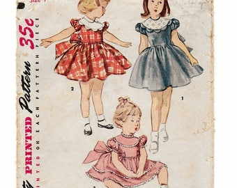 """A Short, Puff Sleeve, Gathered Skirt, Back Tie, Scallop Trim Dress Pattern for Children: Size 1, Breast 20"""" • Simplicity 4480"""